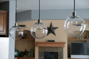Globe pendant lighting crisp airy and funthese lights transformed the entire feeling of our kitchen they are magicallike giant floating bubbles the transparency is wonderful aloadofball Choice Image
