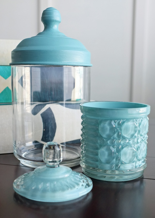 Using paint to coordinate mis matched glass canisters for Glass bathroom canisters