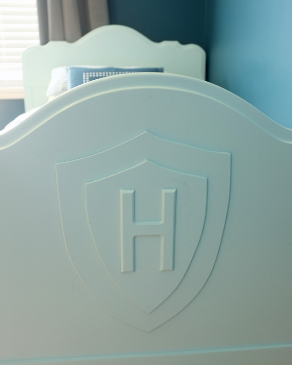 So cool...a DIY shield on footboard of boys bed