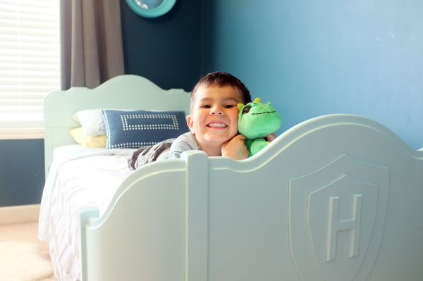 Sweet antique bed makeover for a boy