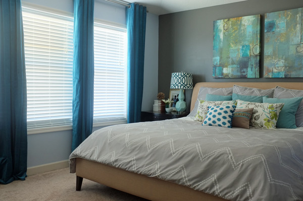 Beautiful use of teal in the master bedroom