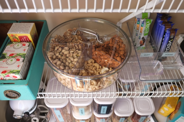 Genius! Use a kitchen organizer to sort and store nuts. This one is a spinning turntable.