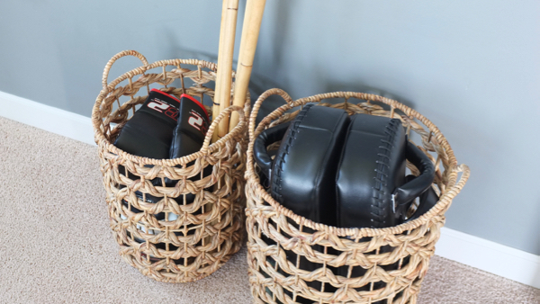 Nice way to store workout gear in decorative baskets.