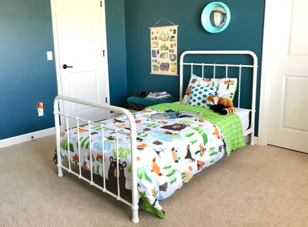 Fun camping-themed boys room. Love the vintage-style school chart.
